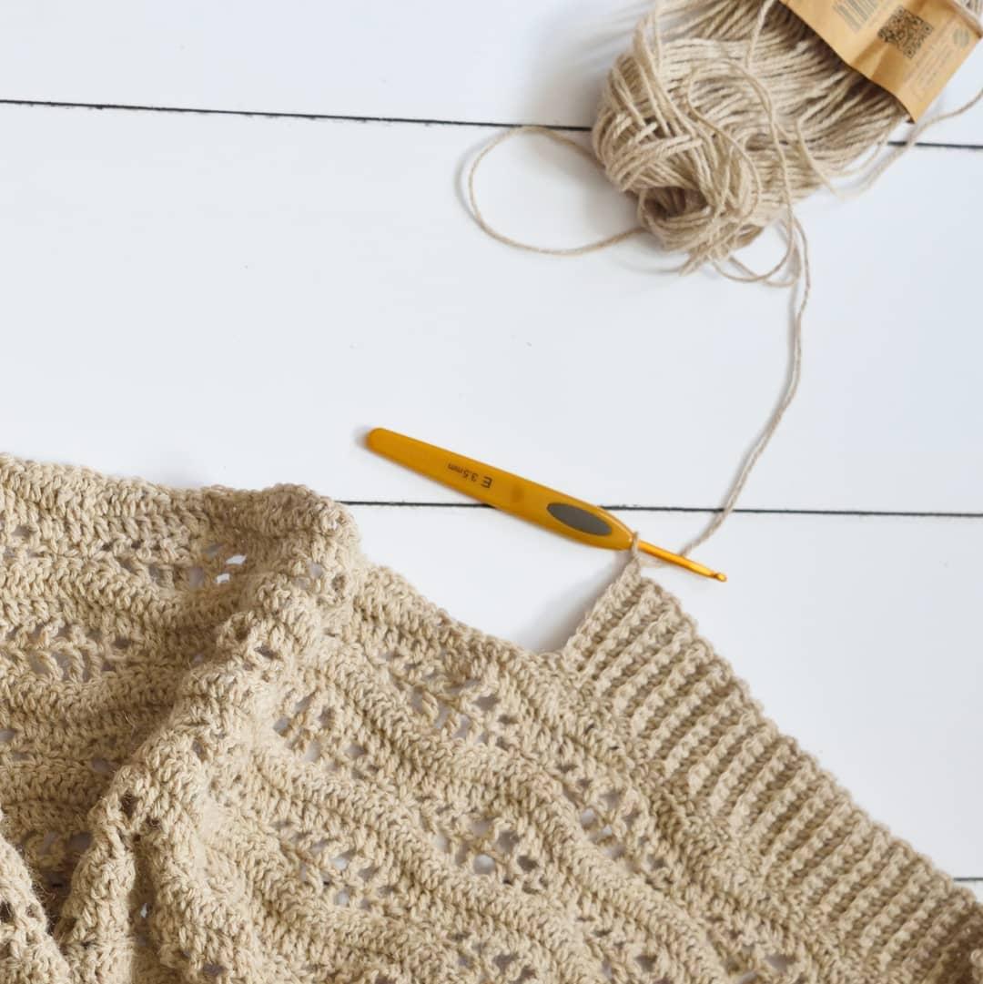 beige crochet work on white wood