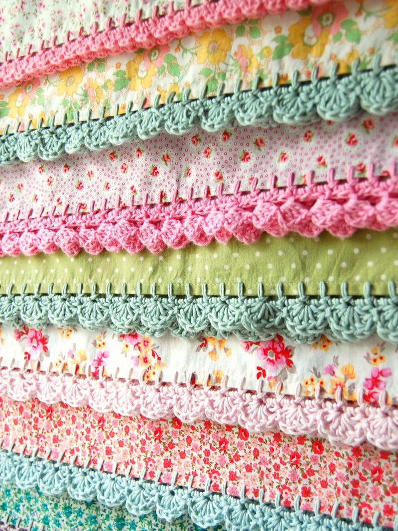 pile of bedding with crochet trimming