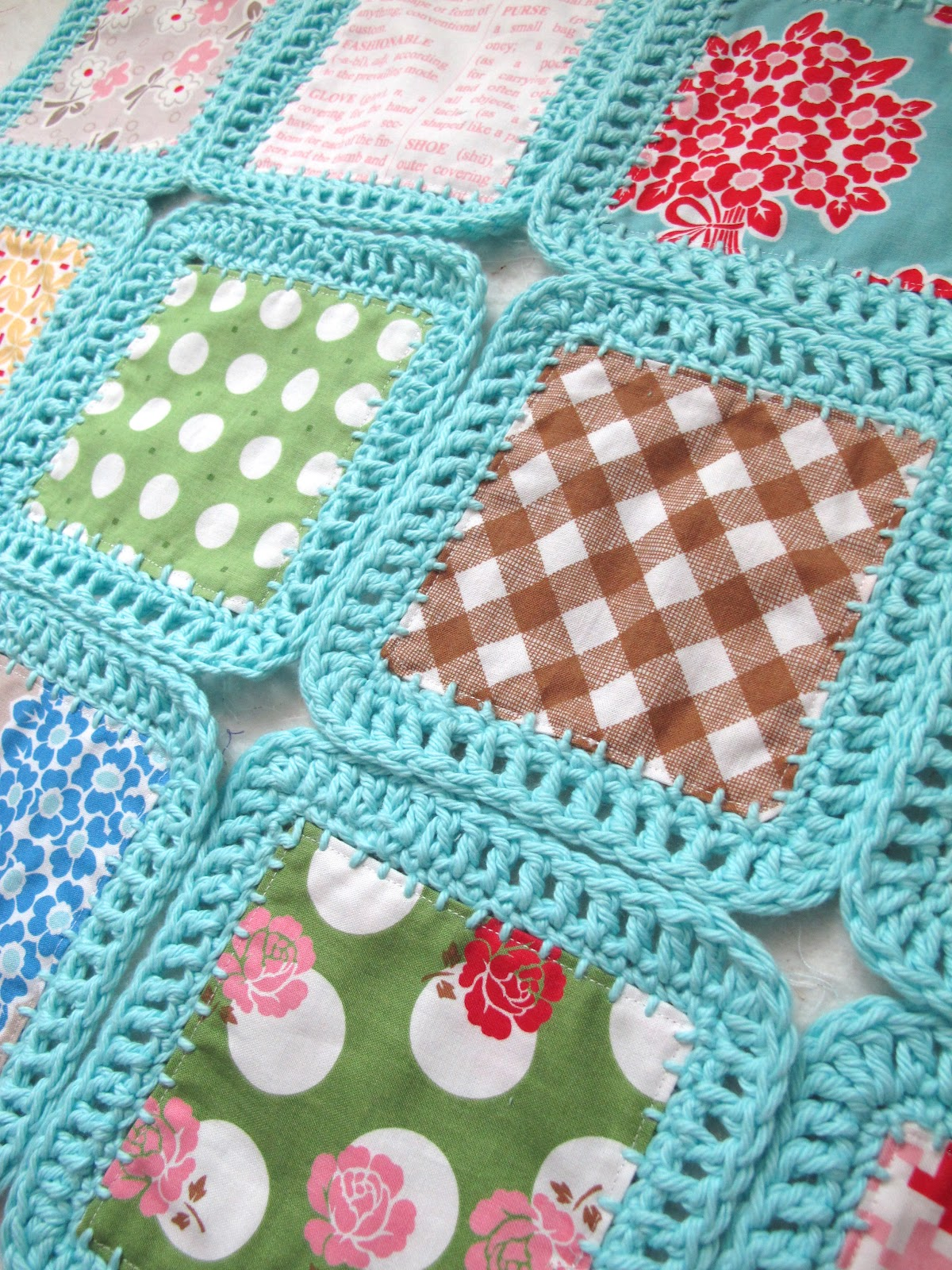 squares of fabric with crocheted edgings