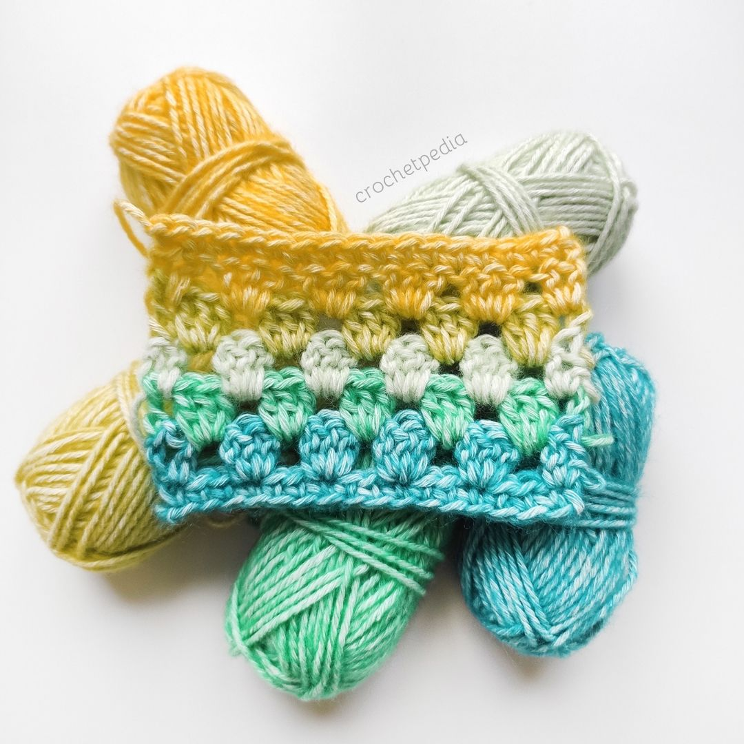 swatch of granny stripe stitch in blue, green and yellow