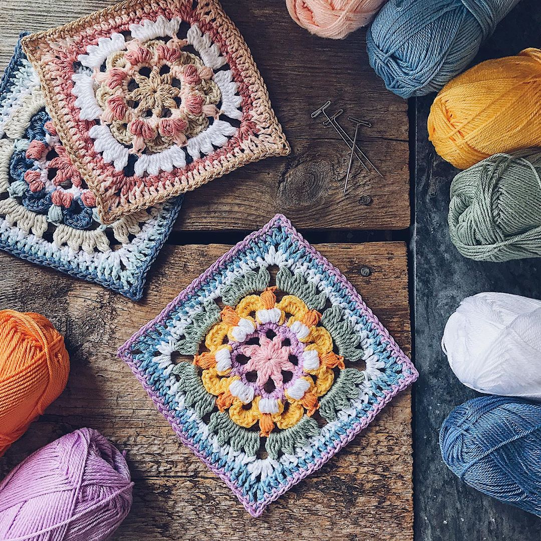 crochet squares on wooden background