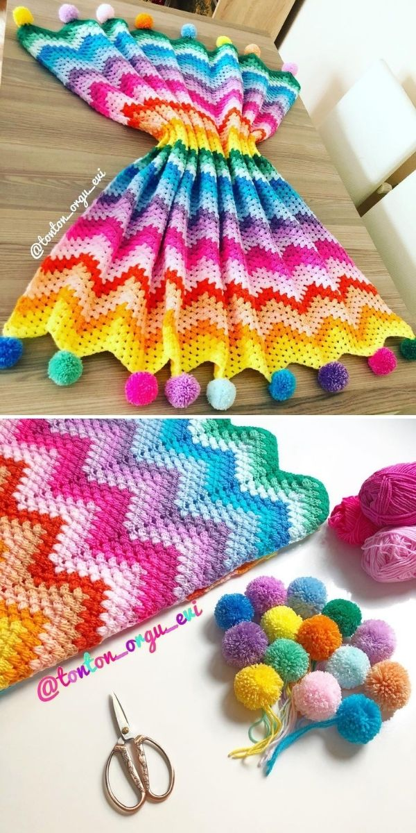 bright rainbow blanket with pompoms