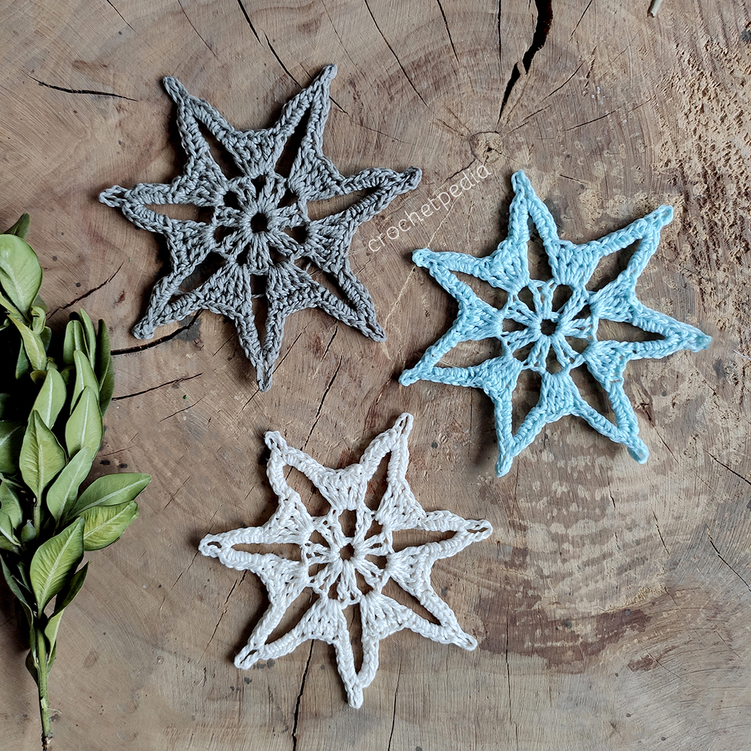 three small snowflakes in different colors