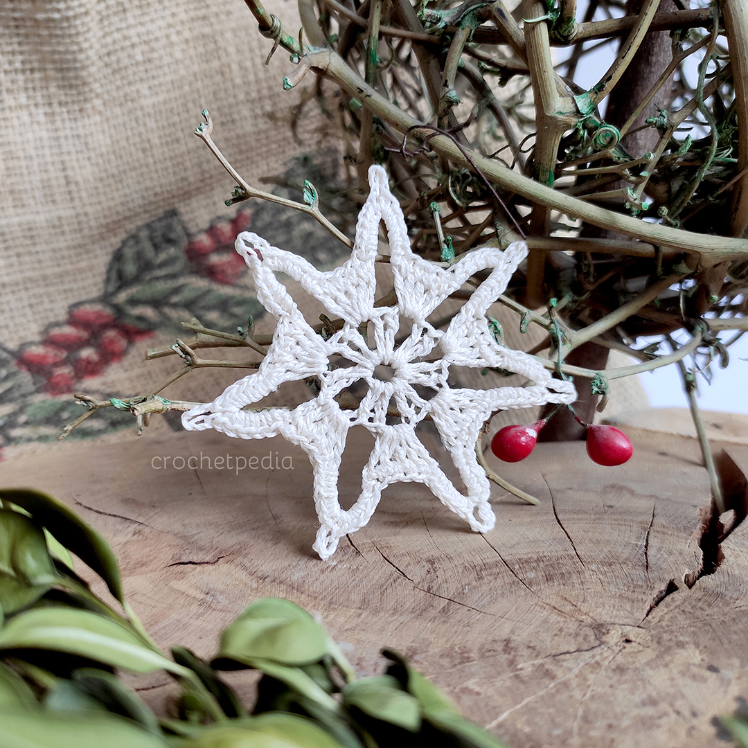 small snowflake on wood