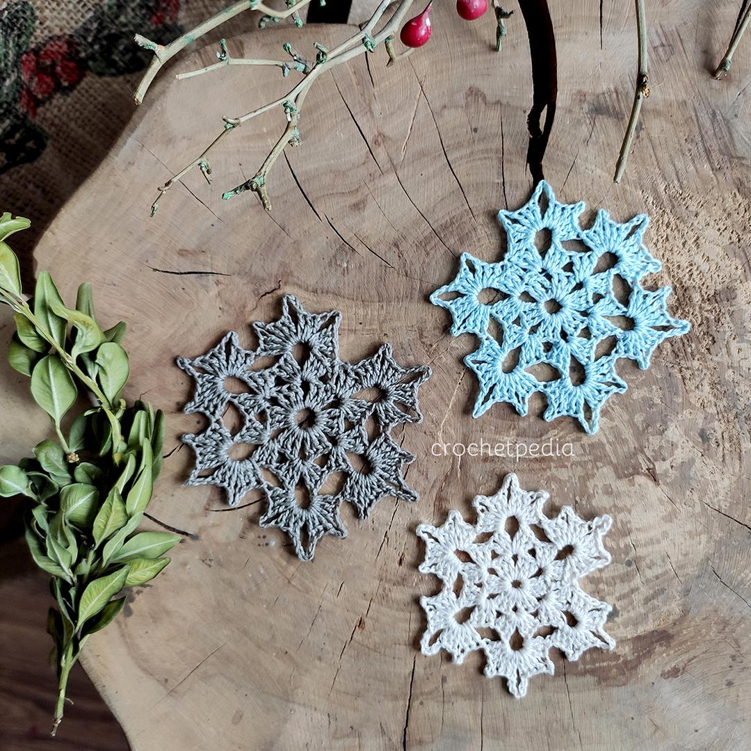 three snowflakes on wood