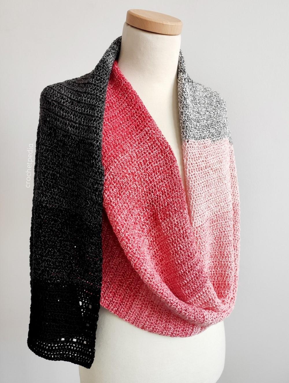 crochet scarf in red and black, draped