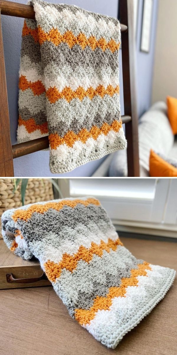 grey blanket with orange accents on ladder