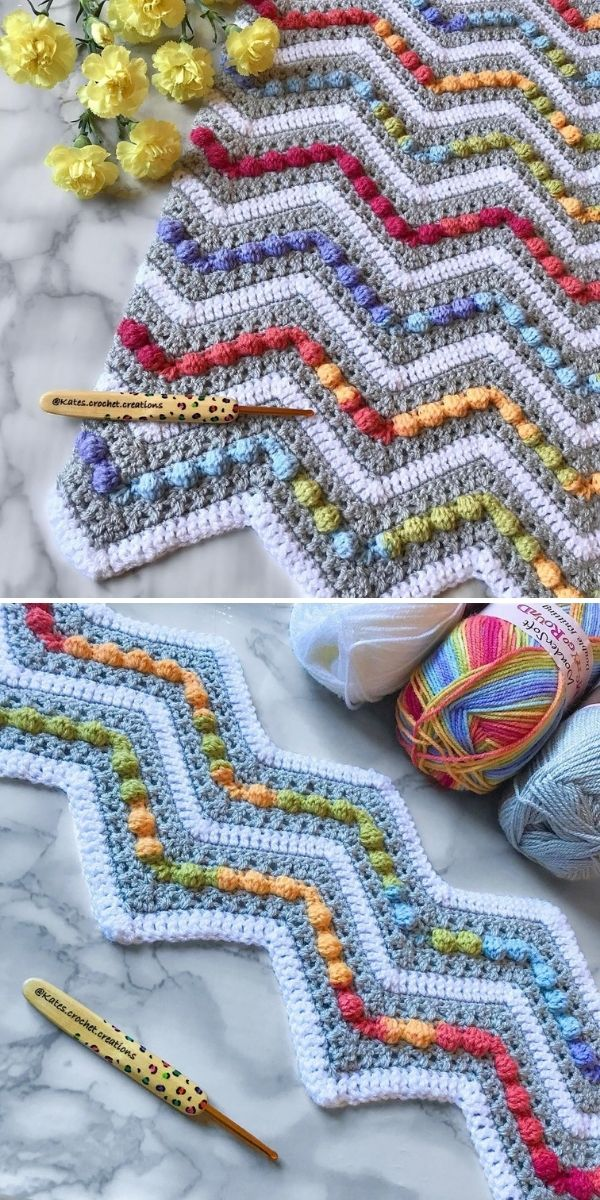 grey and white blanket with colorful bobbles