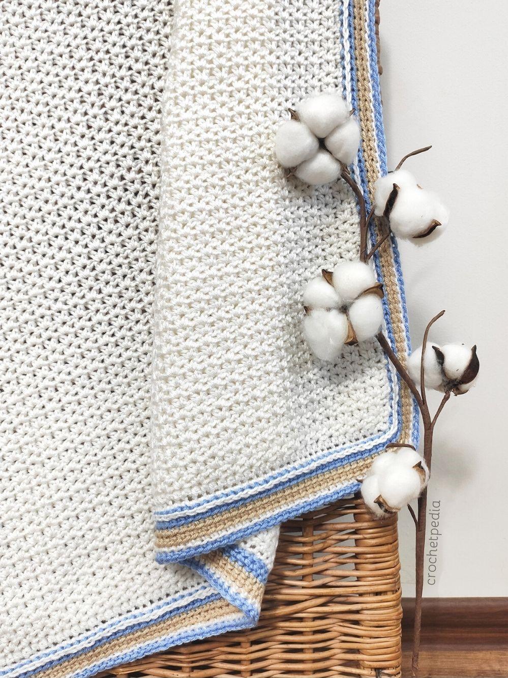 detail of white baby blanket