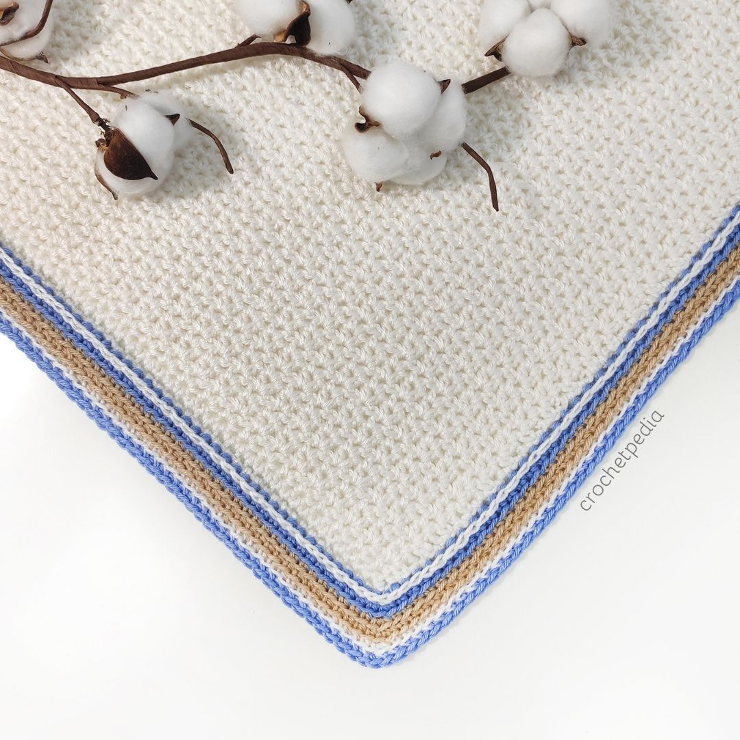 corner of a blanket with visible edging