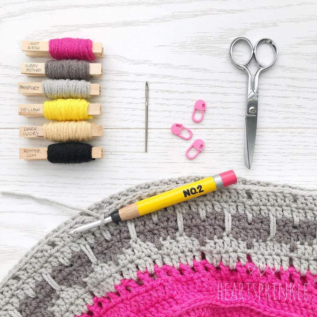 yarn swatches on bobbins