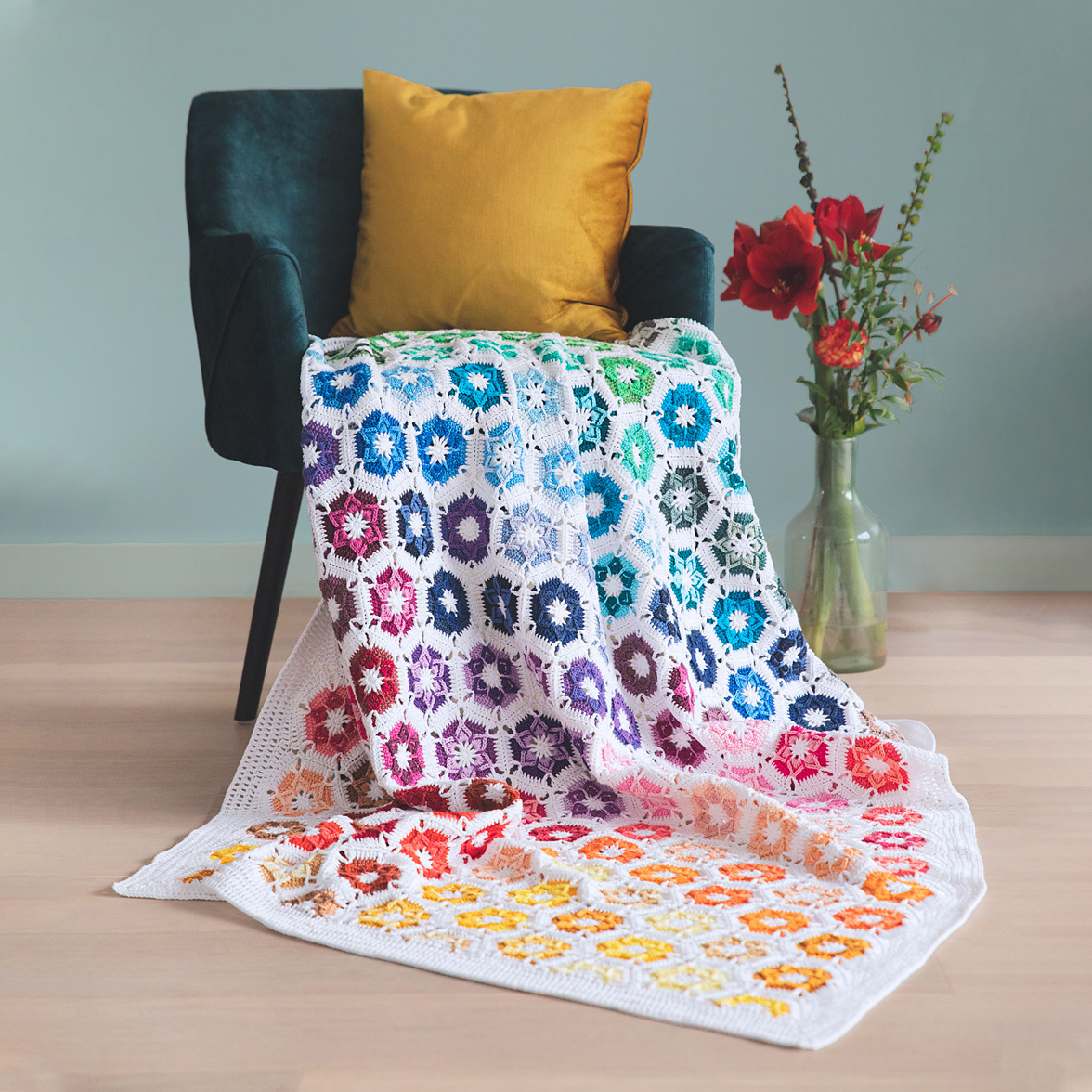 colorful crochet blanket on a chair